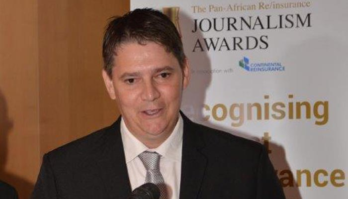 Gareth Stokes receives his award as Pan African Re/Insurance Journalist of the Year