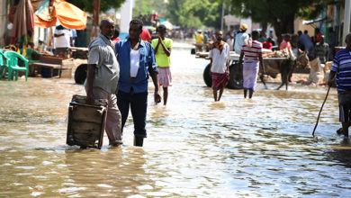 People walk though flooded waters in the main street of Beletweyne, Somalia on April 27, 2018. Beletweyne is currently experiencing its worst flooding and lot civilians have already been displaced. AMISOM Photo