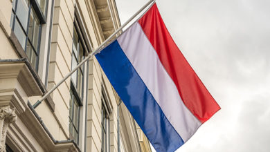 Flag of the Netherlands waving in the wind in the University city of Utrecht.