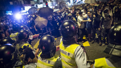 Hong Kong, China: Riot police disperse protesters with baton at the occupied area in Mongkok district.