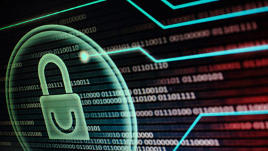 Computer monitor screen displaying padlock symbol in a circular light bubble. binary code data bits background. red and blue colour. cyber security concept.