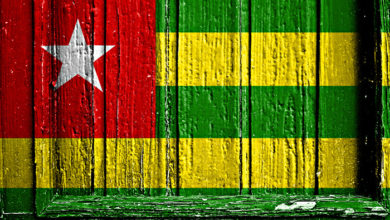 Flag of Togo painted on wooden frame