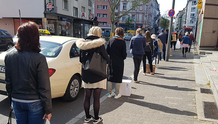 Socially distanced queue outside a reopening store in Germany. Credit: iStock/Piera Marlena Buechler