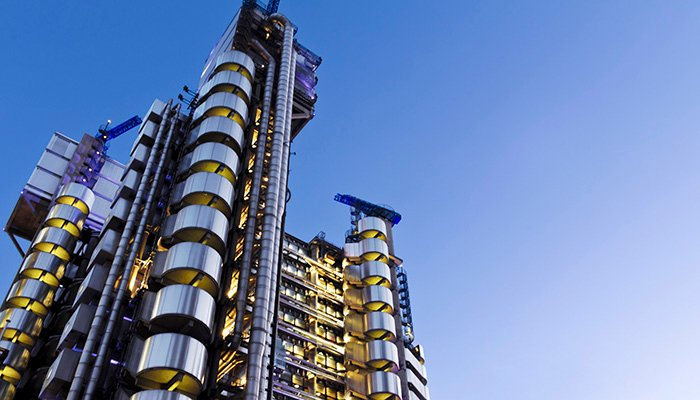 The Lloyd's Building (also known as The Inside-Out Building) with copy space. It is the home of the insurance institution Lloyd's of London, and is located at One Lime Street, in the City of London, England.