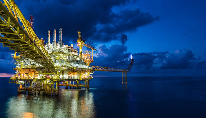 Panorama of oil and gas central processing platform in sun set where produced, treat the hydrocarbon then sent to refinery , petrochemical , power generation plant and tanker barge for export.