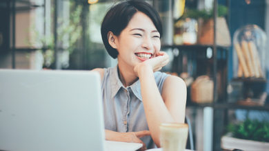 Asian young business girl working with laptop in coffee shop cafe; Shutterstock ID 552553072; Purchase Order: Shutterstock_Portfolio Package_09102020; Job: ; Client/Licensee: Zurich Insurance Company Ltd; Other: