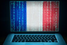 France security system. Laptop with French flag, code and digits on the screen. Internet and network hacking protection concept.