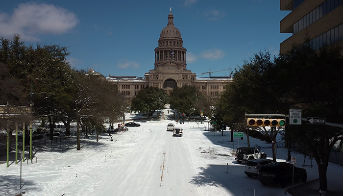Austin, Texas – February 15, 2021: Snow covers Congress Avenue near the state capitol after a winter storm. Credit: Shutterstock/Travel_with_me