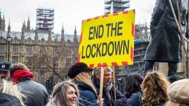 LONDON, ENGLAND- 14 December 2020: Anti-lockdown protesters at a protest in Parliament Square, organised by the National Alliance for freedom from lockdowns
