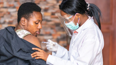 medical personnel administers a vaccine to a patient