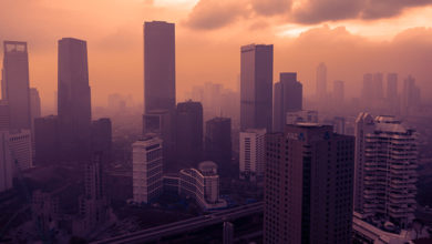 JAKARTA - Indonesia. July 15, 2019: Aerial view of Jakarta city covered by dust smog at sunset time