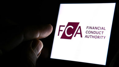 Stone / United Kingdom - March 4 2020: FCA Financial Conduct Authority logo on the smartphone and finger pointing at it in the dark room. FCA is a financial regulatory body in the UK. Concept.