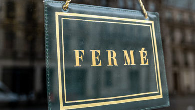 """Sign at a shop window with the french text: """"Ferme"""" that means """"Closed"""""""