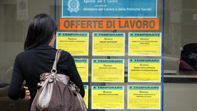 Italy - Milan April4,2018 - job offers - girl in front of the window of an agency for temporary work, unemployment and economic crisis.