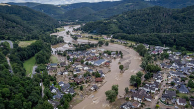 The Ahr river flows past houses destroyed by floods in Insul, Germany, July 2021.