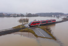 Flooding Germany .Flooded road passing through the railway. A road under water. Germany 2021