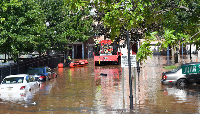 New Brunswick, NJ USA - September 2, 2021: Citizens of the City of New Brunswick rescued by the fire department after flooding from Hurricane Ida.