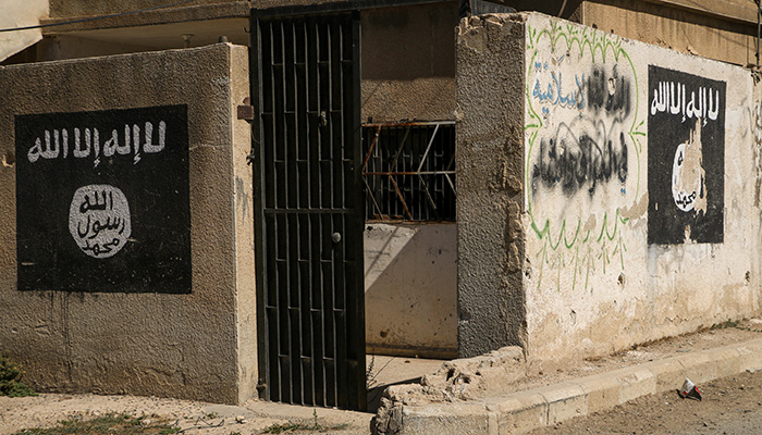 IS logos painted on walls in Aleppo, Syria. Credit: Shutterstock/Mohammad Bash