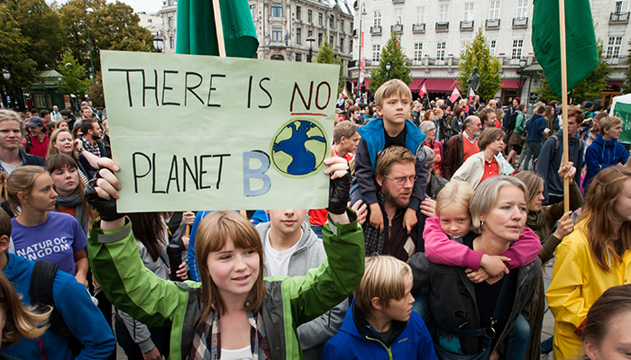 """Oslo, Norway - September 21, 2014: A sign reads, """"There Is No Planet B"""", as parents carry children among thousands marching through central Oslo, Norway, to support action on global climate change, September 21, 2014. According to organizers of """"The People's Climate March"""", the Oslo demonstration was one of 2,808 solidarity events in 166 countries, which they claim was """"the largest climate march in history""""."""