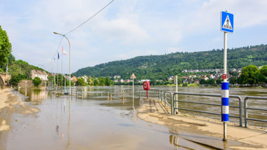 Wasserbillig, Luxembourg - July 17, 2021: The Moselle river floods the boardwalk and riverside road after heavy rains