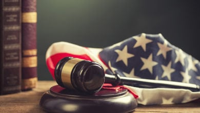 Wooden Gavel with American Flag on a wooden table